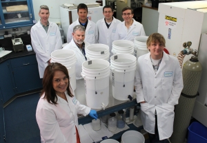 Several staff members from the Water Quality Lab – pictured here surrounding the test filters – have worked on the project since 2010. Back row, left to right: Eric Abbott, Bruce Hale, Ryan Gregg, Zeke Campbell and Chris Schulz. Front row, left to right: Rhonda Birdnow and Ian Babson. Not pictured: Steve Lohman (retired), Maria Rose (Lab), Chris Crumley (now in Water Control), Roger Hausen (retired), Pranab Sharma (former employee) and Jim Hodge (retired).