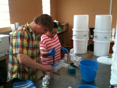Ian Babson, left, stands next to a colleague in Guatemala who helped test a new filter that could cheaply and easily clean drinking water for locals.