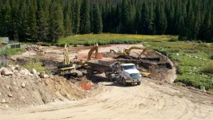 Crews work to construct the settling pond on the Fraser River on the east side of U.S. Highway 40 near the entrance of the Mary Jane ski area. (Photo taken September 2011.)