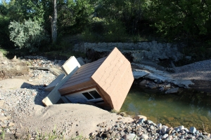Ralston Reservoir's outflow gauge house toppled over during the floods, taking the water-measuring device with it.