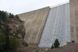 Water cascades down the spillway at Gross Reservoir a week after the floods tore through the area.