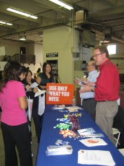 Matt Bond, Denver Water communications specialist (in red) and Brian Haggerty, Denver Water human resources specialist, talk to students at a Denver Public Schools career fair.