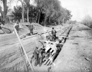 Crews lay a 48-inch wood-stave pipe in County Road 1 in this 1910 photo.