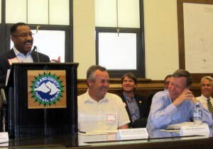 From L to R: Penfield Tate III, Denver Board of Water Commissioners; Grand County Commissioner James Newberry; and Gov. John Hickenlooper share a light moment during the CRCA signing between Grand and Summit counties, Denver Water and the Clinton Ditch & Reservoir Co. in May 2012.