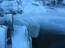 Water freezes around the release valves at Eleven Mile Reservoir.