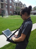 Reyna Yagi, conservation technician, c.evaluates a sprinkler system at an apartment complex.