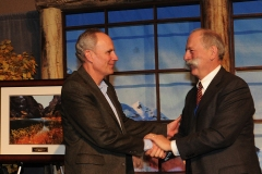 "David Robbins (right), 2012 ""Water Leader of the Year,"" congratulates Lochhead at the award ceremony."