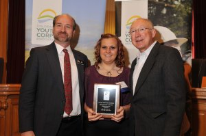 Kelsey Bowers accepts her Corpsmembers of the Year award from Rep. Lebsock (left) and Sen. Udall.