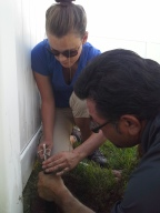Conservation technicians Jenelle Rhodes and Rick Alvarado adjust a sprinkler head during an irrigation audit.