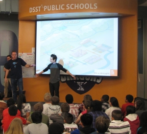 Matt Bond, Denver Water's youth education manager, uses a DSST-Cole Middle School student to demonstrate the Continental Divide and its impacts on water in Colorado.