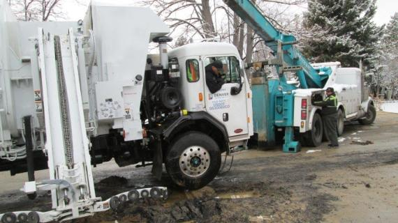 On Saturday, Feb. 21, 2015, Denver Water repaired a 6-inch-diameter water pipe leak after a Denver Public Works trash truck was towed out from a washed-out road patch.