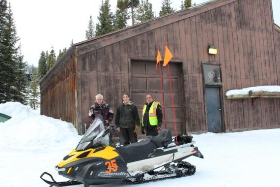 Left to right: Dave Shaw, Denver Water utility worker; Kyle Keller, Denver Water utility worker; and Bob Dart, Winter Park director of mountain maintenance; standing in front of the resort's pump house. The pump house sits on top of the Vasquez Canal.