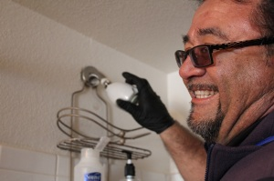 Denver Water employee Rick Alvarado installs a high-efficiency showerhead in a Denver area residence, one of 120  on this day!