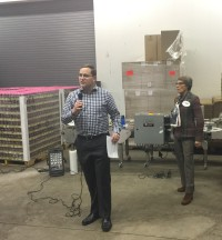 Michael Thomas talks about partnering with the brewing industry on water efficiency at Epic Brewing during a Town Hall presentation sponsored by Senator Lucia Guzman (right).
