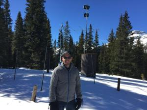 Nathan Elder, water resource engineer, stands next to a SNOTEL measuring site near Silverton, where he attended snow school.