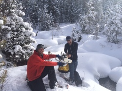 Water Quality Investigators John Feldhauser (left) and James Berrier (right) sample water from a creek in Summit County. Denver Water's Water Quality team takes yearly hikes, weekly backcountry rides, and snowshoe treks into the mountains to sample water straight from the source.