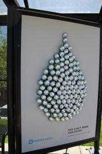 """Recycled aluminum cans make up this water drop to illustrate the point, """"You can't make this stuff, so please use only what you need."""""""