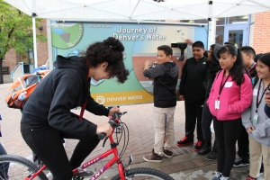 Students have fun playing and learning with the Water Wall at the Denver Metro Water Festival at the Auraria Campus in May.