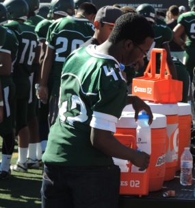 George Washington High School requested water bottles for the football team because the players prefer drinking water to sports drinks.