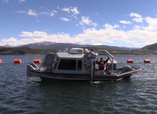 The survey team uses single and multi-beam sonar to measure the depths of the reservoir.