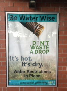A poster at a bus shelter reminds residents to water wise.
