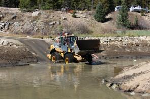CDOT crews scooped 520 tons of sediment out of Denver Water's settling pond near Winter Park Ski Resort.