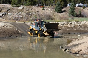 CDOT crews scooped 520 tons of sediment out of Denver Water's settling pond near Winter Park Ski Resort.