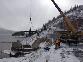 The 6-ton steel plug is carefully placed into the Morning Glory spillway at Dillon Reservoir