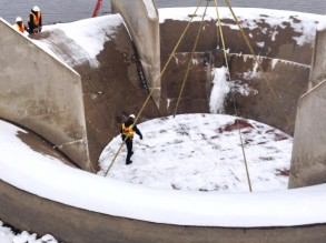 The plug helps prevent chunks of ice and snow from falling into the spillway.