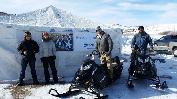 Denver Water staff worked every part of the tournament to ensure its success. Pictured here in front ofthe registration tent is Jason Finehout (left) and Katie Knoll from Public Affairs; and AndrewStetler and Ryan Rayfield, caretakers at Williams Fork Dam.