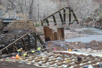 Crews work on the new High Line Canal diversion dam before high water flooded the site.