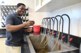 Mac Noah, water treatment tech operator, checks a sample at the Denver Water Recycling Plant.