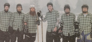 Emergency Management specialist Marcelo Ferreira, second from left, and his fellow Moose Slayers get ready to play in the 12th annual Can-Am Pond Hockey Tournament in Lake Placid, New York, in January 2016.