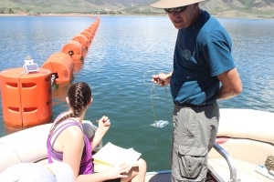 Alicia Christensen and Craig Rahencamp from the Denver Zoo drop the robot into the waters of Dillon Reservoir.