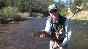 Fly Fishing guide Pat Dorsey shows off a rainbow trout in Cheesman Canyon.