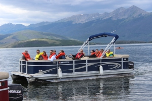 Employees board a pontoon boat and head out across Dillon Reservoir to see operations from the water.