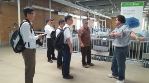 Denver Water's Dave Brancio shows a delegation of Taiwanese engineers the filter beds at Denver Water's Recycling Plant.