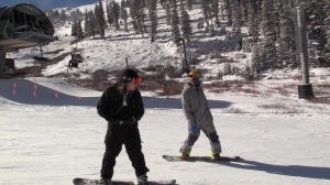 Snowboarders at Arapahoe Basin