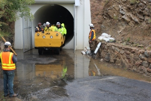 The inspection team arrives at the tunnel's eastern portal near Grant in Park County.
