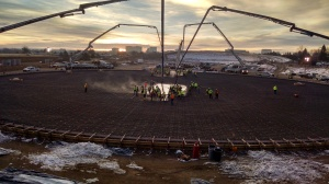 crews placing concrete for storage tank at Hillcrest